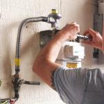 Gas engineer trainee working on gas meter - ACS Membership Cost