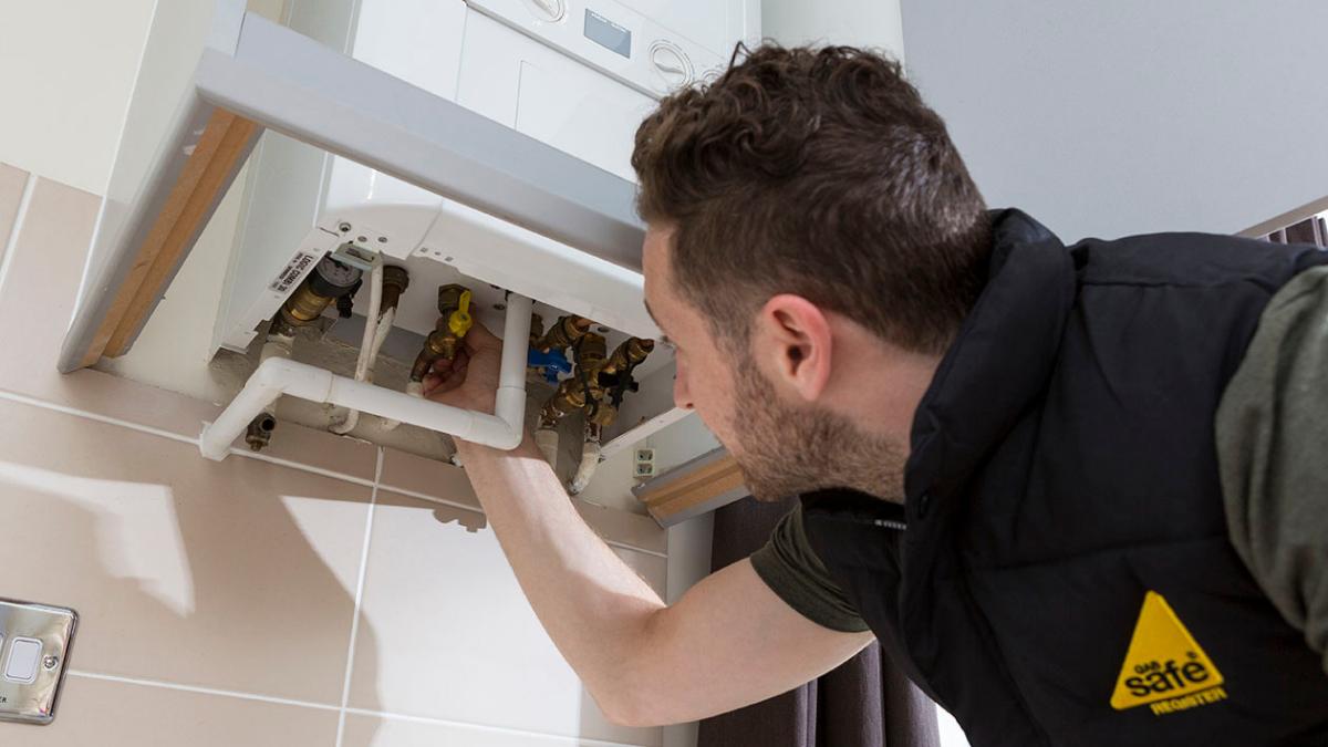 Gas Safety - Gas safe engineer servicing a boiler