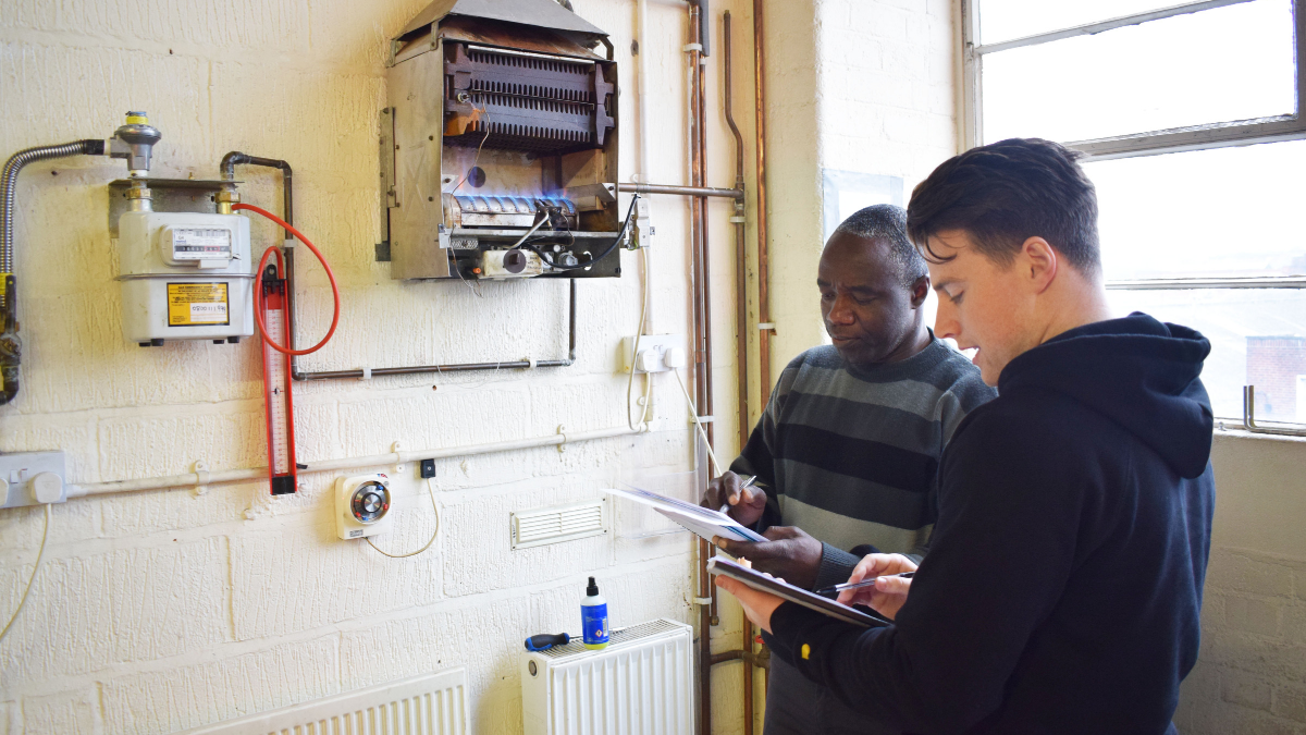 Two gas students working to become gas engineers
