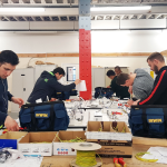 Electrical trainees in workshop