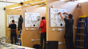Mental health in the trades - students in electrical workshop