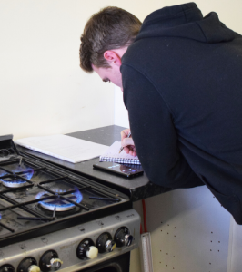 Trade Directories - Gas engineer working on gas hob