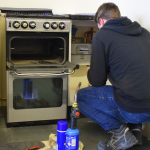 Trade Directories - Gas Engineer working on gas cooker