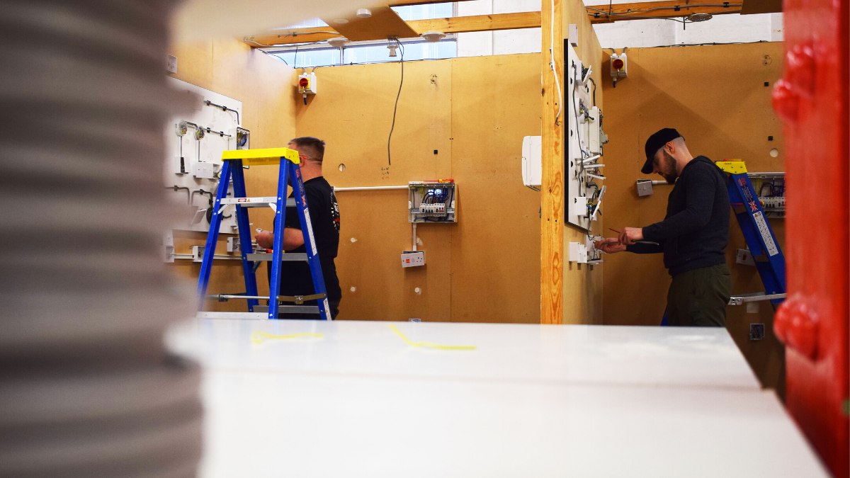 Electrical Training Courses - Students working on installation in workshop