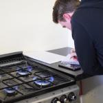Customer Service - Engineer servicing a boiler
