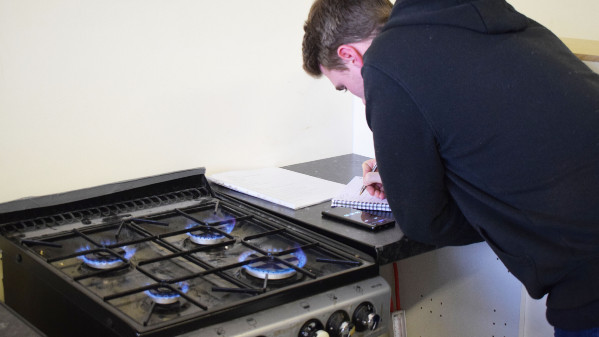 Customer Service - Engineer servicing a boiler