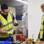 Two students undertake pipe soldering in the Options Skills workshop as we reopen after covid-19