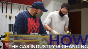Two gas industry students working on pipe skills in the gas workshop