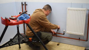 Plumbing student working in pipes in the workshop - how to respond to negative reviews