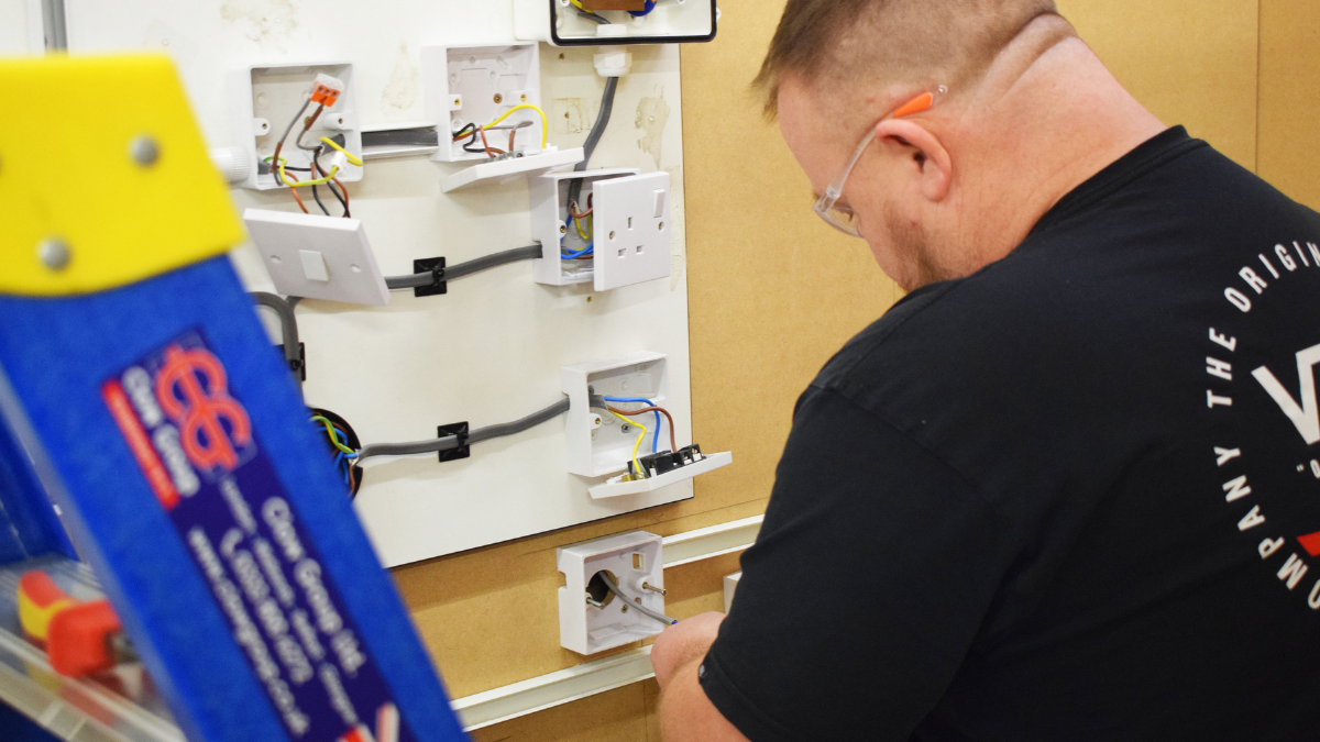 Electrical trade student working on wiring