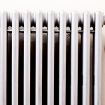 Off-white cast iron radiator to illustrate decarbonisation blog post
