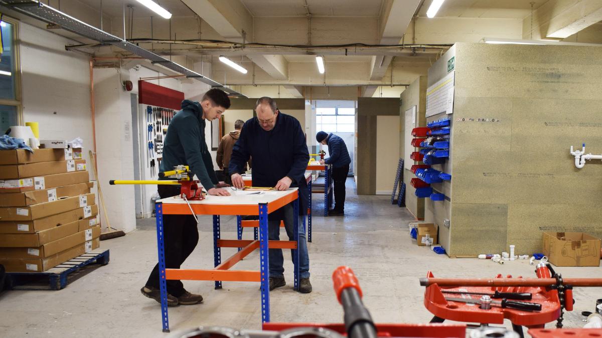 Options Skills Trainee in plumbing workshop