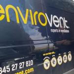 Envirovent employee stood next to company van